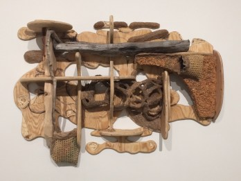 Jessi Reaves, Shelf with Pockets & Braid, 2017 Plywood, driftwood, bond-fire wood, sawdust, wood glue, chair caning, metal, leather, velvet, silk, and ink Courtesy of the artist and Bridget Donahue, New York