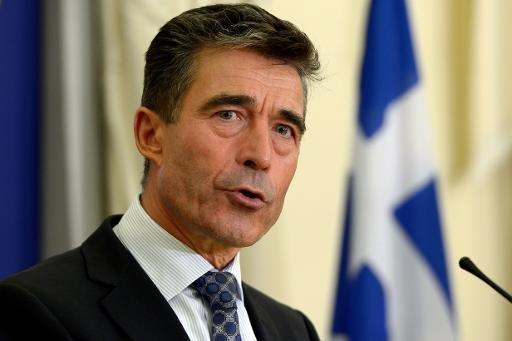 Secrétaire général de l'OTAN Anders Fogh Rasmussen parle lors d'une conférence de presse à Athènes le 10 Octobre 2013