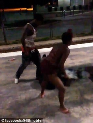 One of the young women in the group hit the man in the head with a skateboard as he lay lying on the ground