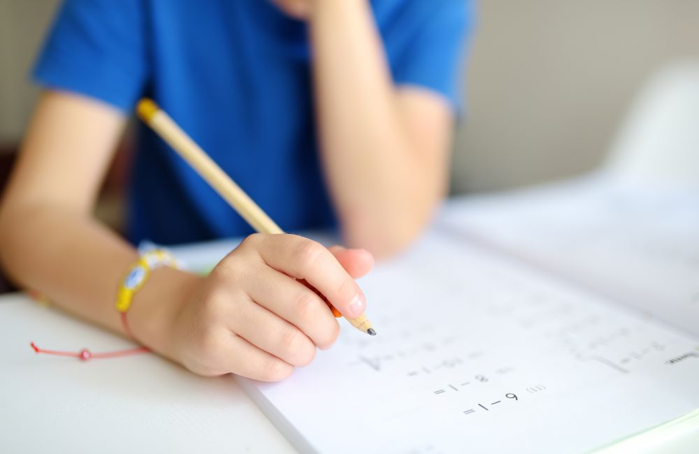 Image of child doing KS1/2 maths tuition online with TLC LIVE