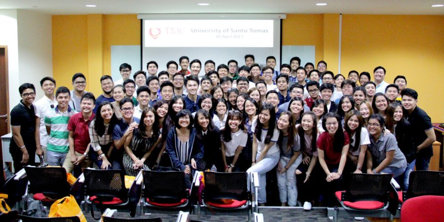 University of Santo Thomas posting for a group photo in TMC Academy Lecture Theater