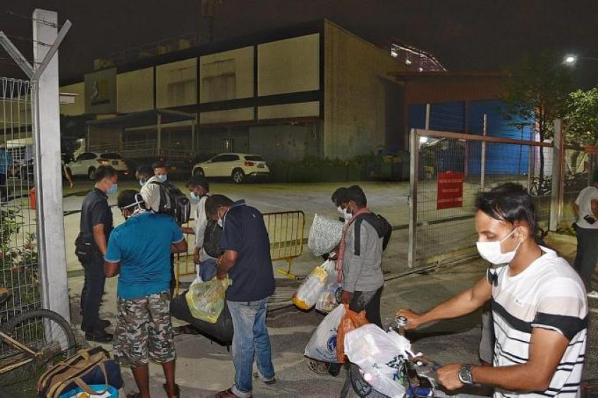 20,000 foreign workers to be quarantined in dorms to stem virus ...