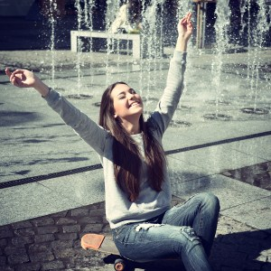 Beautiful excited teen girl pleased youth and sunny spring day s