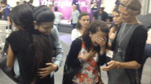 Team praying for girls