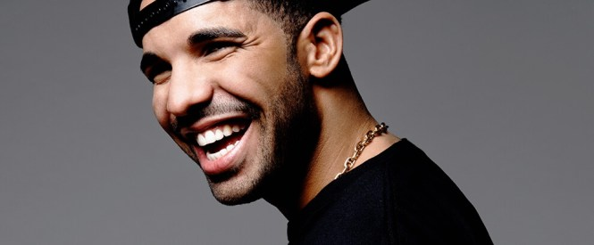 Photo of Drake wearing a black shirt and baseball cap taken from Billboard.com