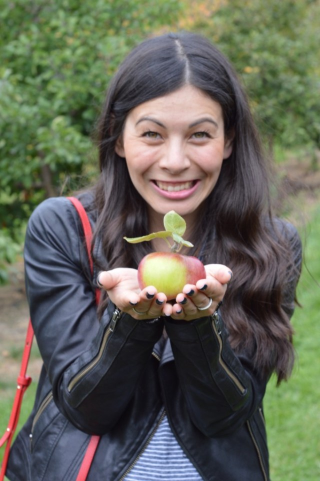 Posing with the most perfect apple.
