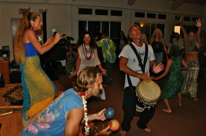 People Drumming and Dancing
