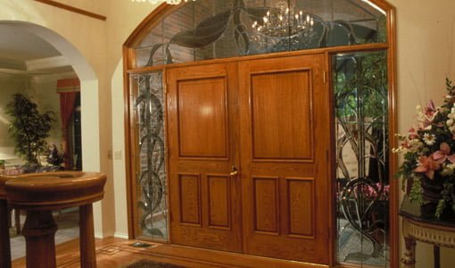 Double wood entry doors with stained glass sidelights