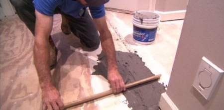 How to Level a Subfloor to Prepare for New Flooring   Today s Homeowner Using floor patching compound to level a subfloor