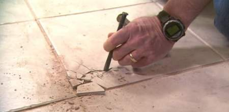 How to Remove and Replace a Damaged Ceramic Tile   Today s Homeowner Removing cracked floor tile