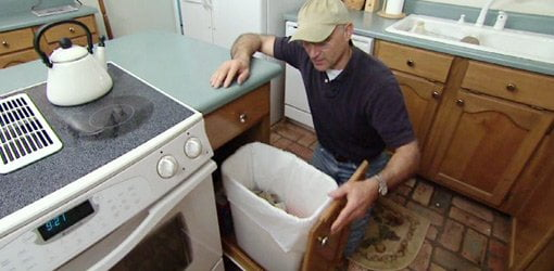 roll-out trash bins in your base cabinet