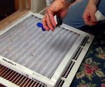 Applying scented extract to return air filter to help reduce musty odors.