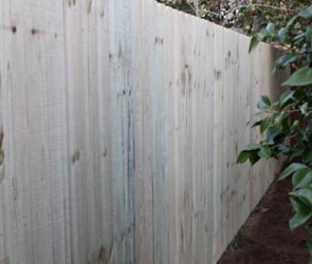 Completed Pressure Treated Wood Privacy Fence