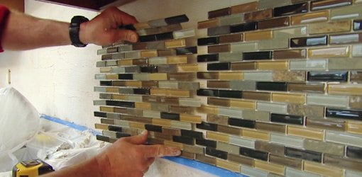 How to install a mosaic tile backsplash todays homeowner installing a sheet of mosaic tile on a kitchen backsplash solutioingenieria Gallery