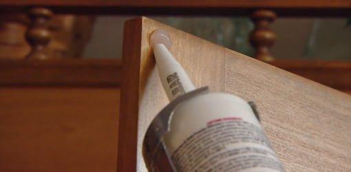 Applying silicone caulking to cabinet door. & DIY Silicone Cabinet Door Bumper Pads | Todayu0027s Homeowner