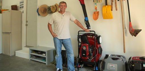 Allen Lyle In Organized Garage With Toro SmartStow Lawn Mower.