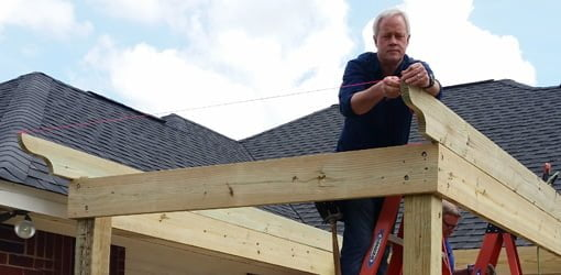 Attaching string to rafters on pergola shade arbor.