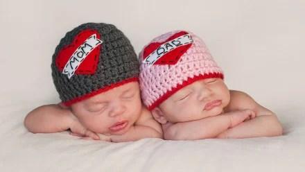 Twin babies wearing knit caps