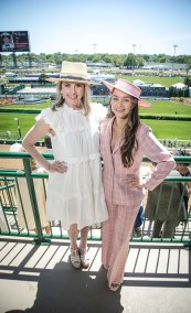 Allison and Natalie Alcock in two contrasting trends: ruffled dress and sleek pantsuit.