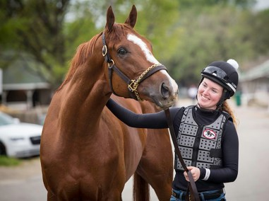 """""""I was riding this horse and there were all these people watching, so I stopped so the kids could look at him and the mom came running over and said, 'They're so proud that you're a woman.' I didn't realize that there are people — little girls and women —watching me out here and rooting for me,"""" says Kylie Wellington, exercise rider for Wayne Lucas and an aspiring jockey."""