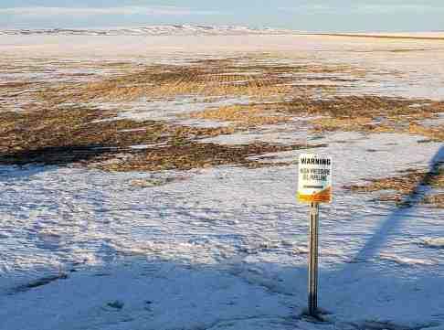 field with buried pipeline