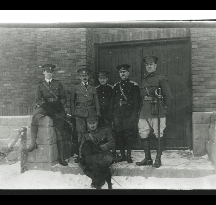 Officers with the 12 Canadian Mounted Rifles standing at the door to the Red Deer Armoury, 1915