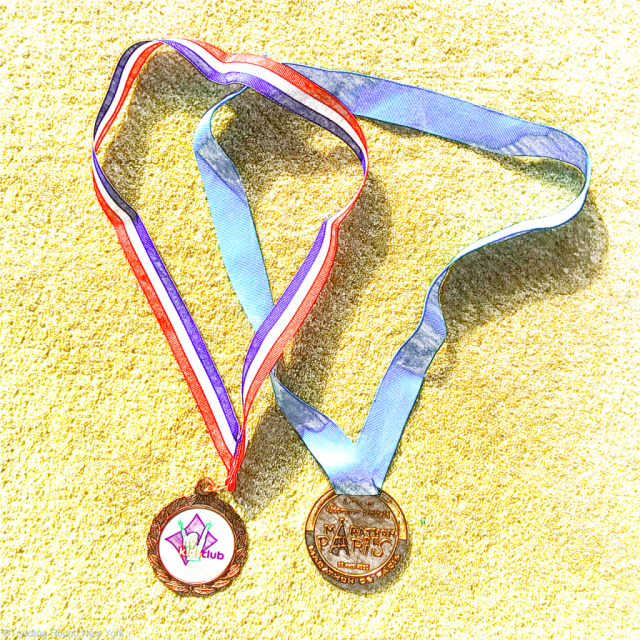 Medals for gymnastics and the Paris Marathon