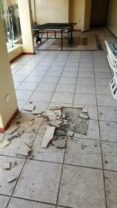 Floor tiles popped and shattered