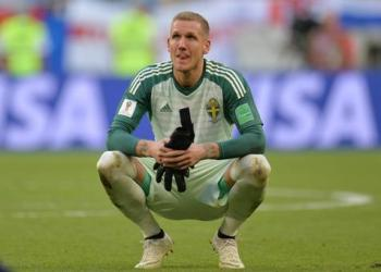epa06871740 Goalkeeper Robin Olsen of Sweden reacts after the FIFA World Cup 2018 quarter final soccer match between Sweden and England in Samara, Russia, 07 July 2018. Sweden lost the match 0-2.  (RESTRICTIONS APPLY: Editorial Use Only, not used in association with any commercial entity - Images must not be used in any form of alert service or push service of any kind including via mobile alert services, downloads to mobile devices or MMS messaging - Images must appear as still images and must not emulate match action video footage - No alteration is made to, and no text or image is superimposed over, any published image which: (a) intentionally obscures or removes a sponsor identification image; or (b) adds or overlays the commercial identification of any third party which is not officially associated with the FIFA World Cup)  EPA/PETER POWELL   EDITORIAL USE ONLY