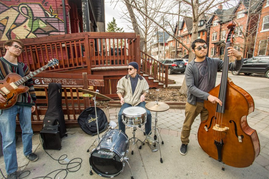 Band performing on street in in Kensington Market Toronto