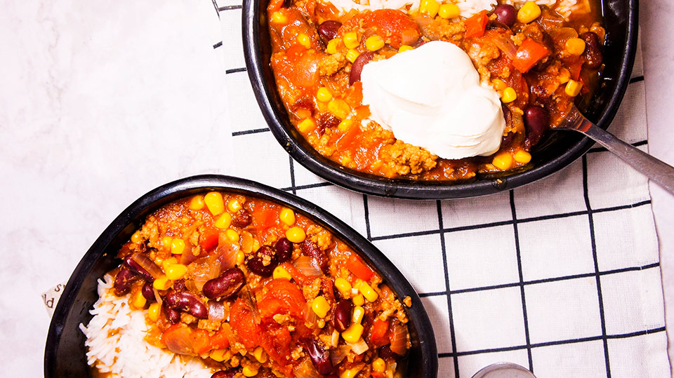 Close up two bowls of chili con carne