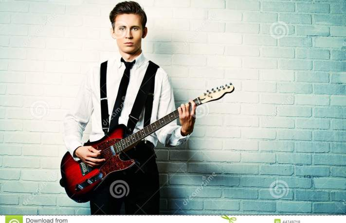 guitarist-expressive-young-man-playing-rock-n-roll-music-his-electric-guitar-retro-vintage-style-44749718