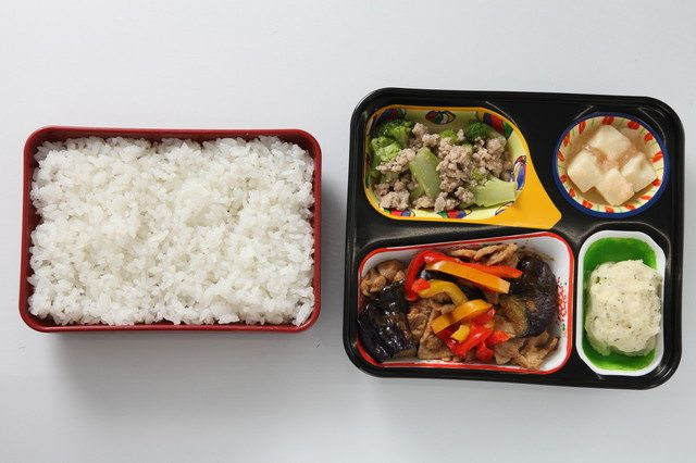 A drunk man has been charged with assaulting the manager of a restaurant because the rice in his order was soft