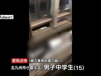 A teenage boy laid down on his back on the track of the Kitakyushu Monorail in January