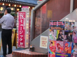 A man smokes a cigarette in front of strip club T.S. Music in Kabukicho (The Tokyo Reporter)