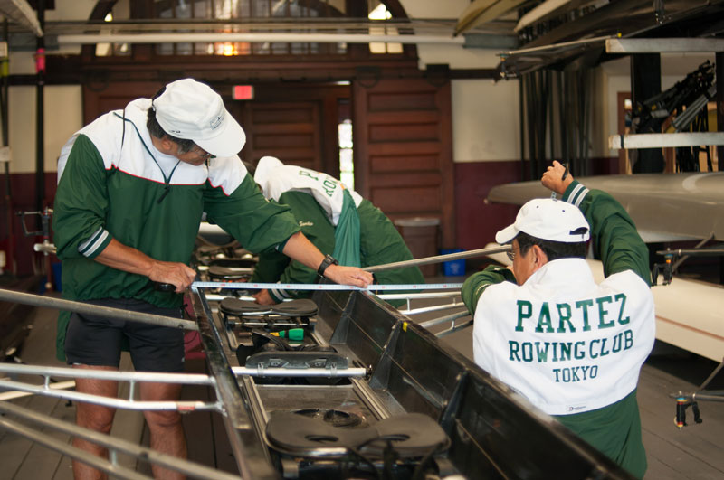 The crew prepares their boat for the race