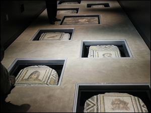 Made with tiny pieces of chiseled stone and glass to depict birds and faces, the 12 mosaics at the Wolfe Center for the Arts at BGSU were first believed to be from authorized excavations in Antioch, Turkey, overseen by Princeton University.
