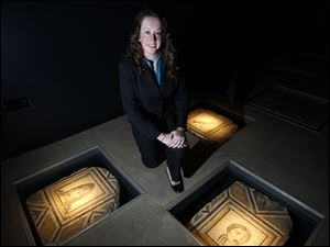 Dr. Stephanie Langin-Hooper, Assistant Professor of Ancient Art History, kneels near ancient mosaics at the Wolfe Center at Bowling Green State University, Tuesday.
