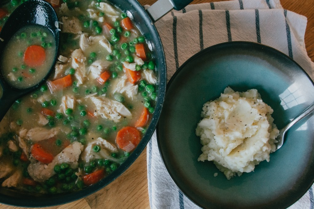 Thickened chicken soup over mashed potatoes