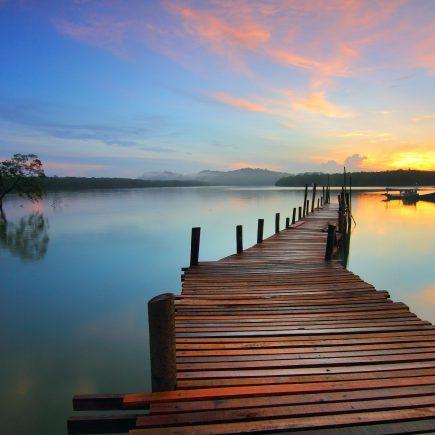 beach pier at sunset