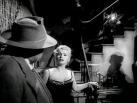 Orson Welles y Zsa Zsa Gabor en un fotograma de la película Touch of evil (título traducido como Sed de mal en España).