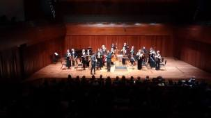 Taking a bow at Britten Sinfonia's premiere of 'My Curves are not Mad', Milton Court London, March 2015