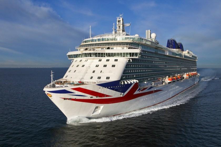 P&O's flagship Britannia, pictured sailing against a blue sky. Photo courtesy of P&O Cruises UK.