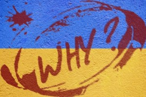 "Ukraine flag with ""why"" graffiti"