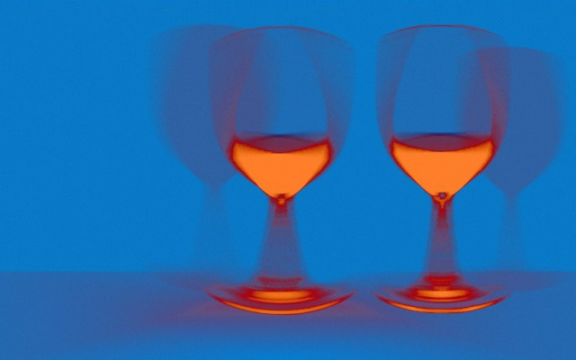 two blurry glasses of wine in hangover vision
