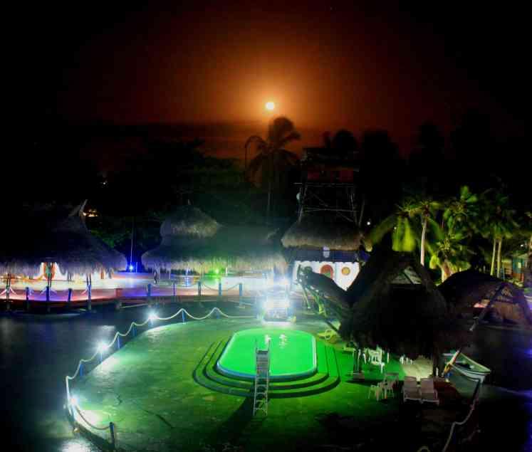 Moonrise from a wood bridge on Isla Mucura