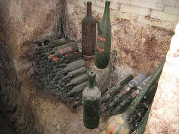 Ancient bottles in Castel Pugna cellar