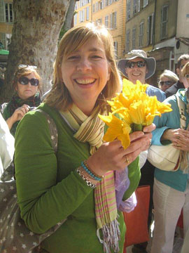 Jennifer Dugdale with zucchini flowers in the market in Aix