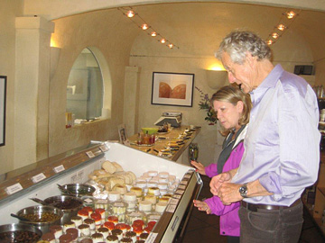 David Wood inspects his cheese