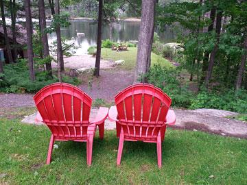 Muskoka chairs and lake